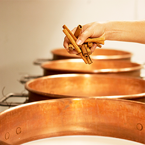 Caramel cooking in copper pots