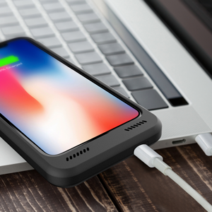 Black BXX Charging Case connected to Macbook to charge, sync and transfer data without removing case