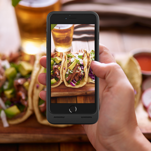 Taking a photo of tacos with the BX190plus battery case on.
