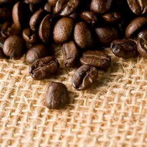 Close up of roasted kona beans on a fabric bag