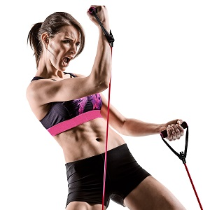 Woman using resistance bands with intensity.