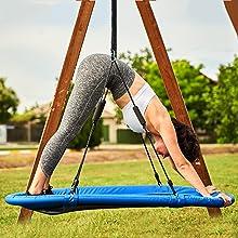 Yoga pose on a platform swing