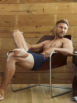 second skin model in chair comfortable enjoying the underwear tommy john boxer briefs