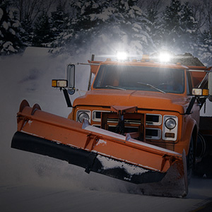 A snow clearer with our LED light bars (off road lights) on