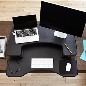the pro plus 36 sits on top of your existing desk and allows you to work comfortably sitting or standing