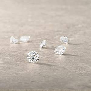 Moissanite cut jemstones on flat surface