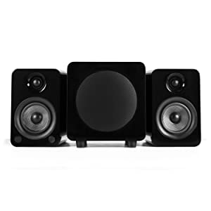 Gloss black YU4 speakers next to black subwoofer