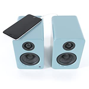 Teal YU2 with iPhone sitting atop left speaker