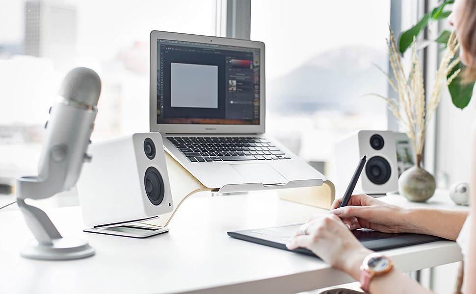 Kanto Matte White YU2 on desk with Desktop speaker stands