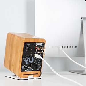 Kanto YU2 Bamboo desktop speakers connected to iMac through USB