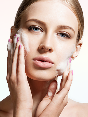 Woman with Touch glycolic acid face wash foam on her face