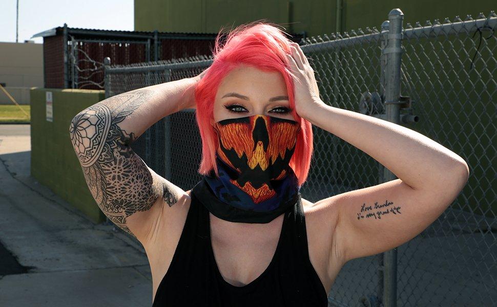 model wearing jack-o-lantern halloween pumpkin seamless mask bandana
