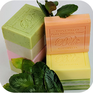 Two stacks of Bela soaps with greenery.