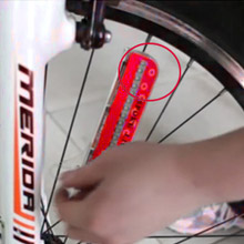 As the picture shows, place the wheel light on the spoke.