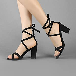 63b728e9d62 ... a trend-right sandal topped with crisscrossing toe straps and  leg-flattering wraparound ankle ties for a chic update to your season- spanning wardrobe.