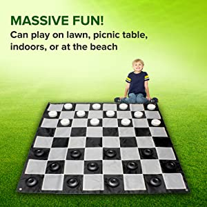 Picture of kid playing game - Massive fun! Can play on lawn, picnic table, indoors, or at the beach