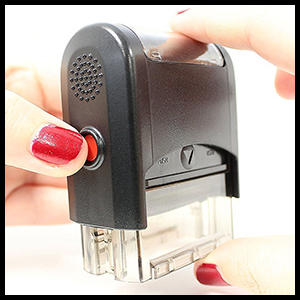Push in stamp base and press red buttons to lock in place.