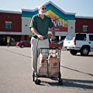 man with shopping cart and groceries