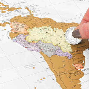 closeup of hand scratching map with coin