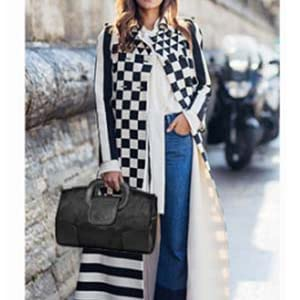 Model wearing the black handbag in her right hand