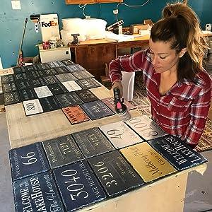 Finishing a batch of plaques