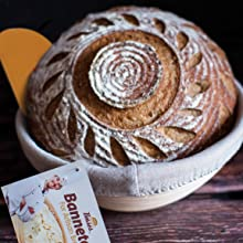 round banneton proofing basket brotform with sourdough scored bread and flexible orange scraper