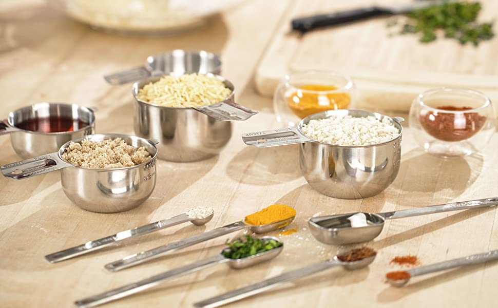 measuring cups and spoons set on kitchen counter