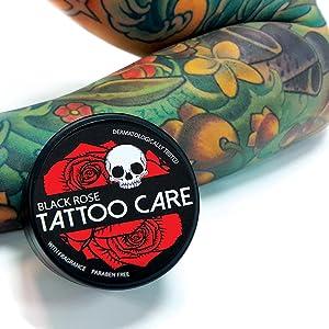 Tattoo Care Black Rose next to tattooed hand