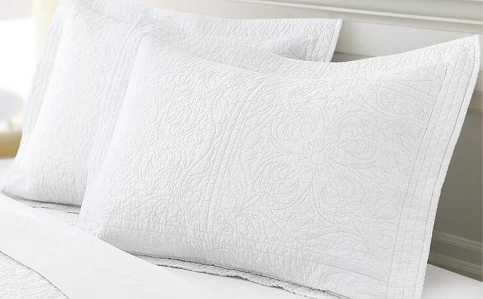 white cotton pillow shams