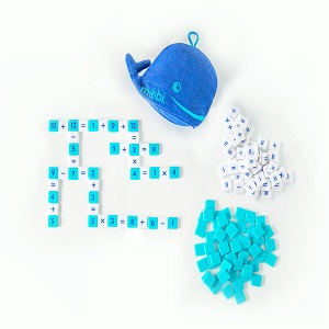 A blue plush whale with tile game pieces.