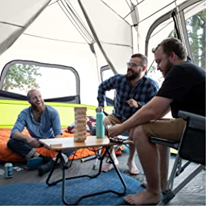 Lifestyle of 12 Person Instant Cabin Tent, friends camping in tent, chairs in tent, room divider