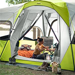 Lifestyle image of large T-Door on 12 Person Instant Cabin Tent, Spacious tent for eating sleeping