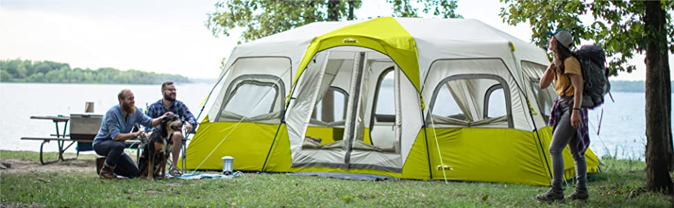 Lifestyle image of core 12 person instant cabin tent light, group of friends camping, large windows