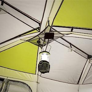 Interior of 12 Person Instant Cabin Tent, Attachable gear loft with organizer and lantern clip