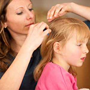 Lice treatment and comb