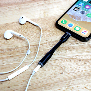 iPhone X with audio adapter in allowing use of 3.5 mm wired earbuds with built-in microphone.