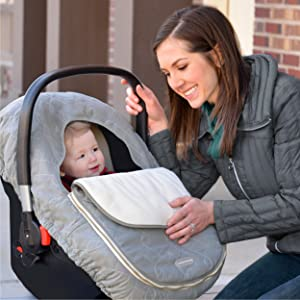 image of baby with car seat cover