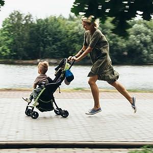 Mom pushing kid in stroller.