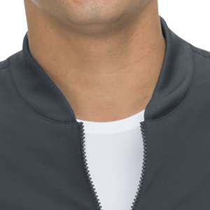 close up of koi Basics 448 men's scrub jacket featuring zip front closure and rib knit collar