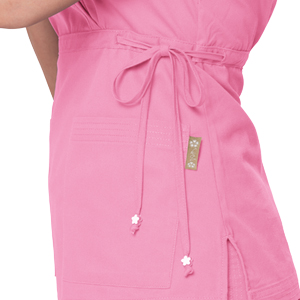 close up of koi classics 137 women's katelyn mock wrap v-neck scrub top featuring floral bead