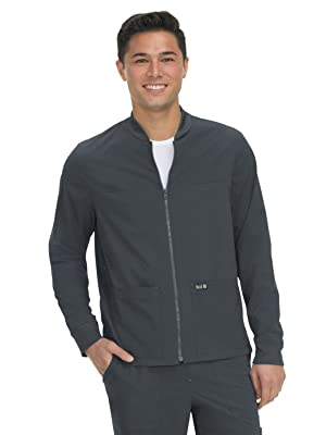 model wearing koi Basics 448 men's scrub jacket with two front pockets and zip up closure