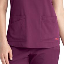 Curved hem shown on Barco Grey's Anatomy Spandex Stretch Women's V-neck Scrub Top
