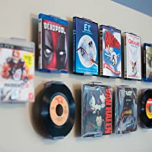 wall design with mounted records and movies, mixed media mounting system, easy to use display