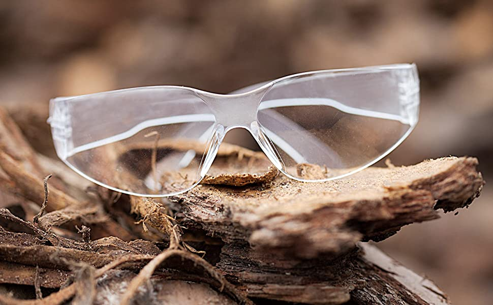 Image of clear lens clear temple safety glasses up close outdoors.