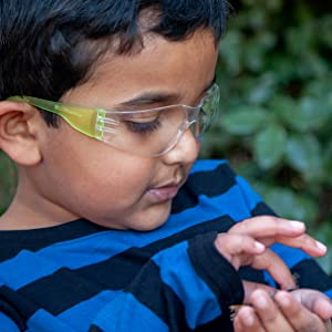 Image of a child exploring nature while wearing safety glasses.