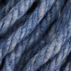 Image of the fibers of a blue wringer mop up close.