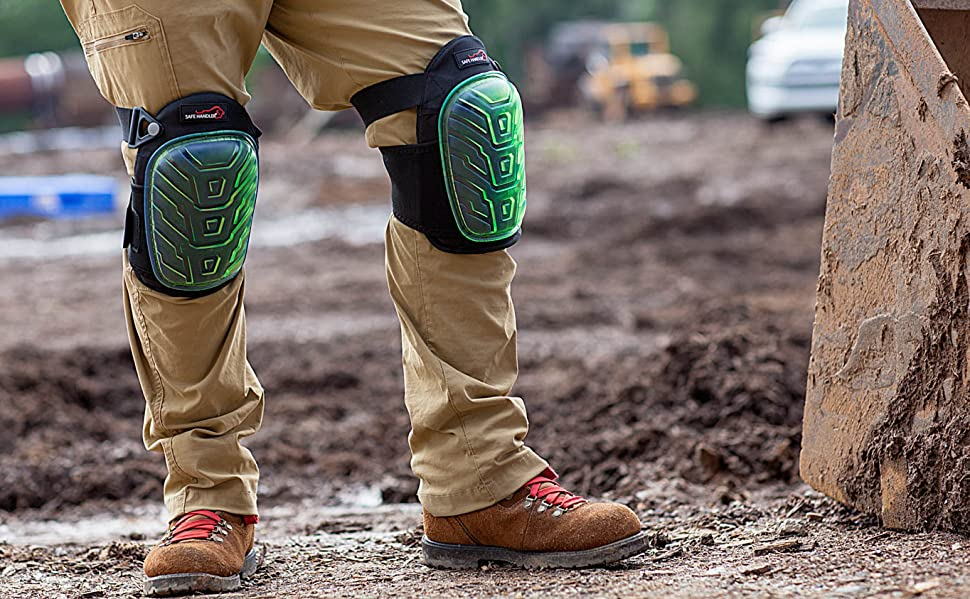 Image of a man wearing knee pad on a worksite.
