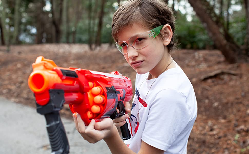 Image of a child wearing kids children's safety glasses while playing with a nerf dart gun.