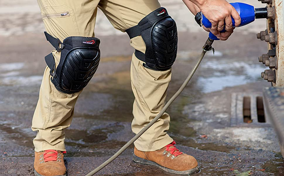 In image of a man wearing knee pads while working outside.