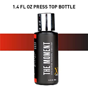 Black bottle of lubricant with silver press-top lid; text reads: 1.4 fl oz press top bottle